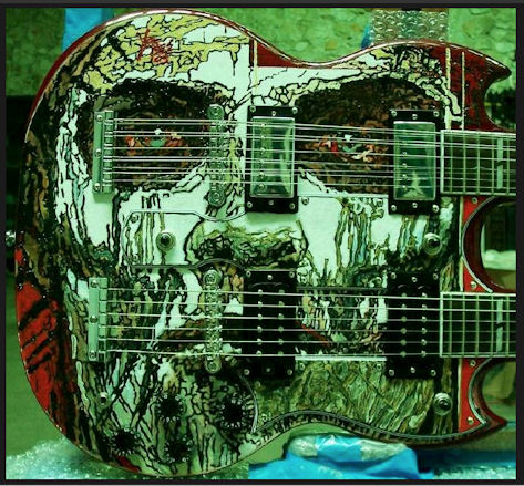 11_mejores_portadas_65_los_lobos_George Yepes - Shotgun Messenger (Custom Double-neck Gibson Guitar - Robert Rodriguez Collection)  2006